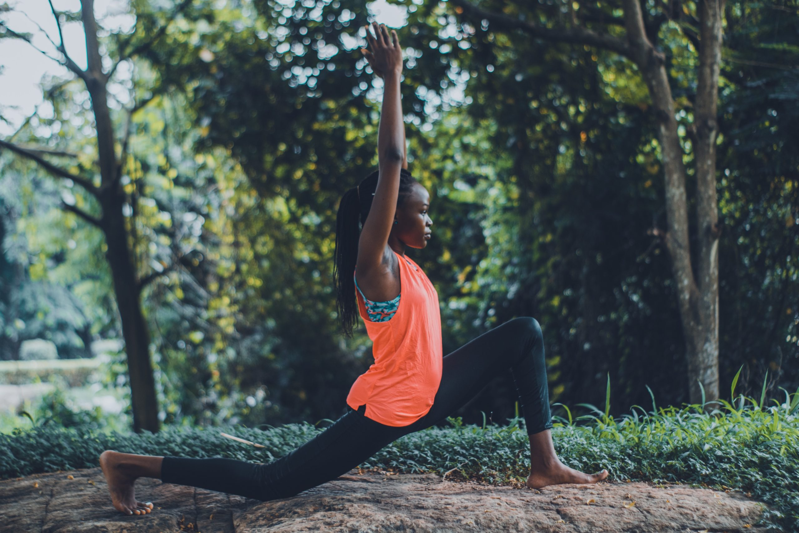 photo-of-woman-in-orange-tank-top-and-black-pants-striking-a-3658399